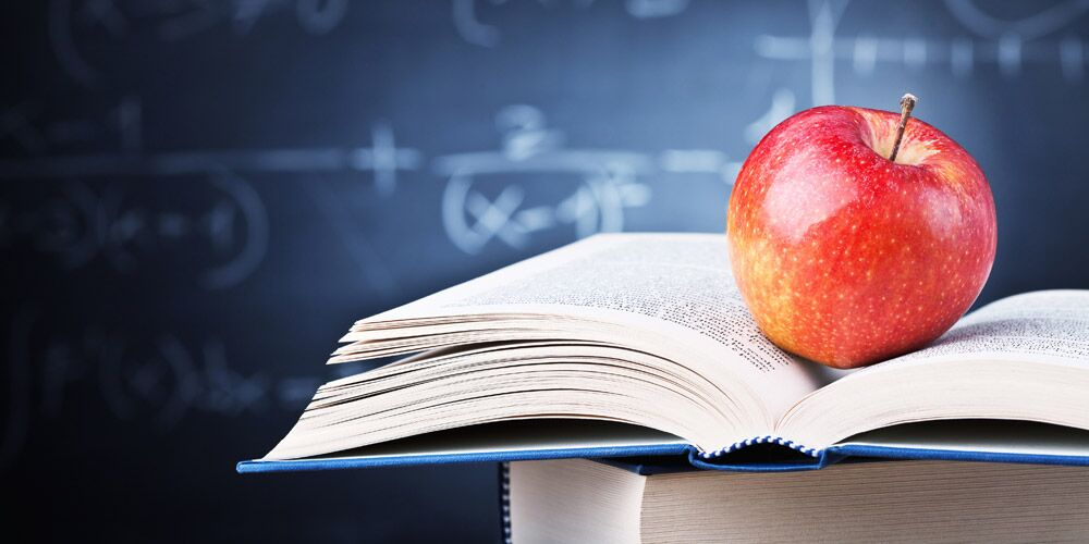 Textbook with Apple