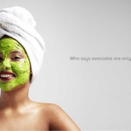 Avocado face mask on woman