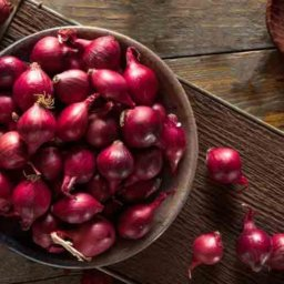 Red pearl onions in bowl